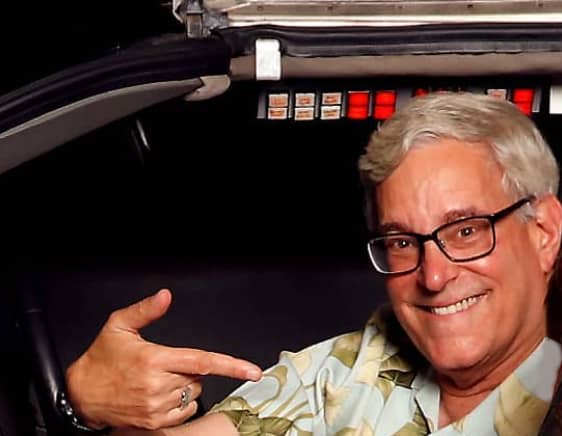 Bob Gale in a Back To The Future DeLorean - © to the owners