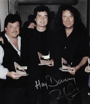 Danny Zelisko with Led Zeppelin's Robert Plant and Jimmy Page in 1995 - © to the owners