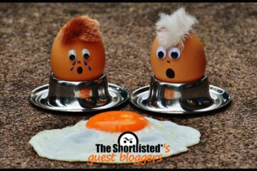 Funny eggs with painted faces are sad in front of a broken fried egg