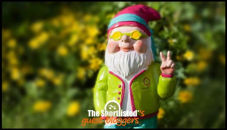 Funny, smiling and cute garden dwarf