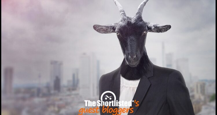 Weird and creepy goat head with a suit and tie photomontage