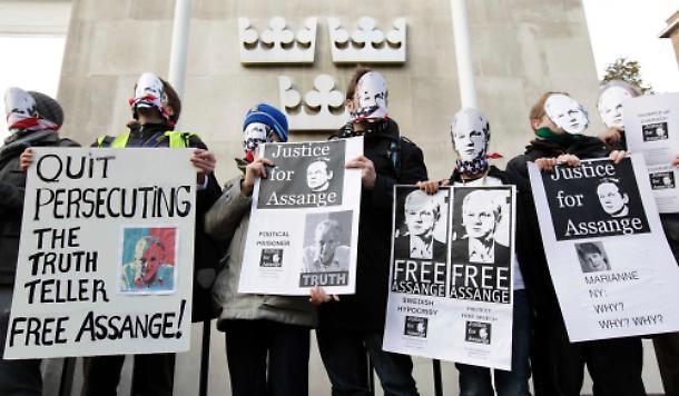 Julian Assange march in London by anonymous