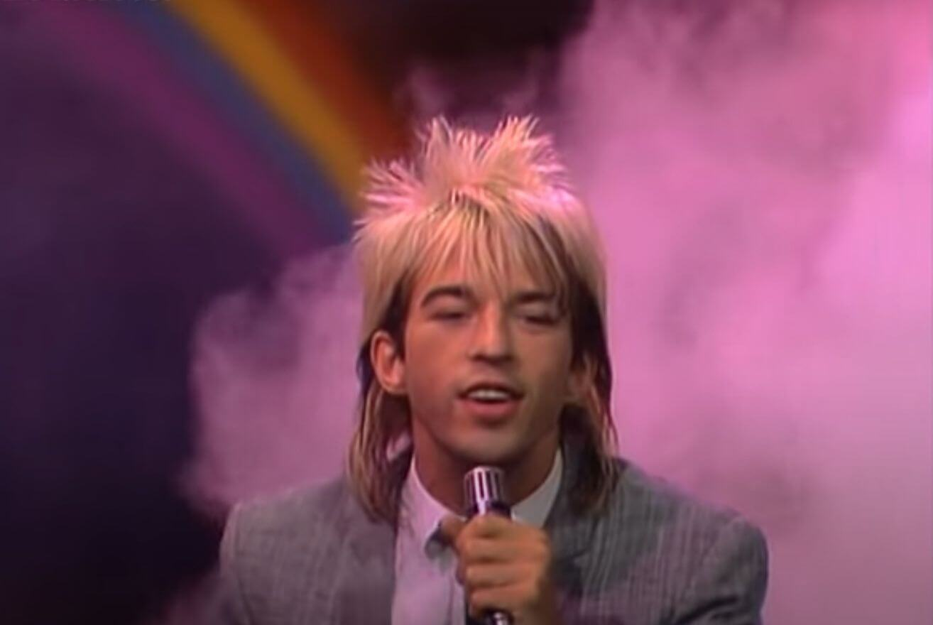 Limahl former Kajagoogoo singer performing The Neverending Story live with rainbow