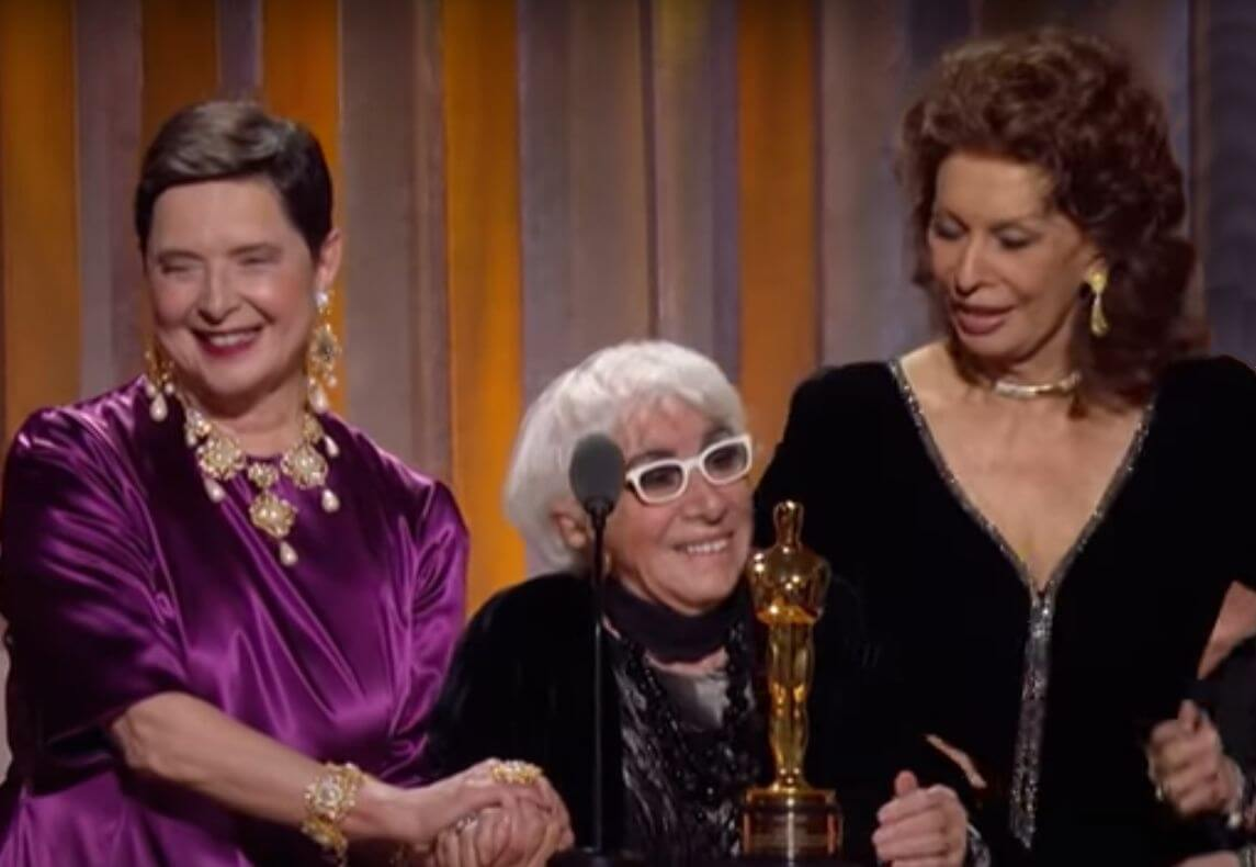 Lina Wertmüller accepts the Honorary Oscar at the Academy Awards with Sophia Loren and Isabella Rossellini