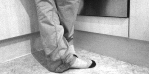 Man's legs in jeans and socks, black and white picture