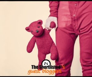 Fucsia man's legs and denim with fucsia teddy bear