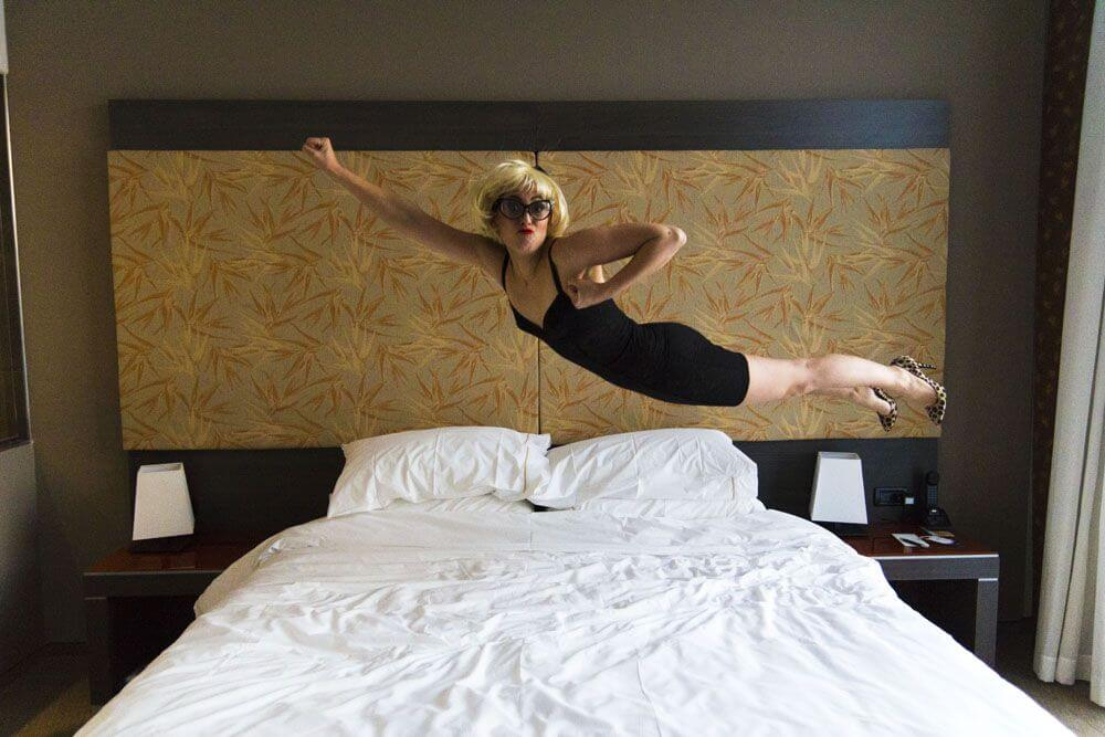 La Spora Veronica Benini, blonde woman jumping on a bed